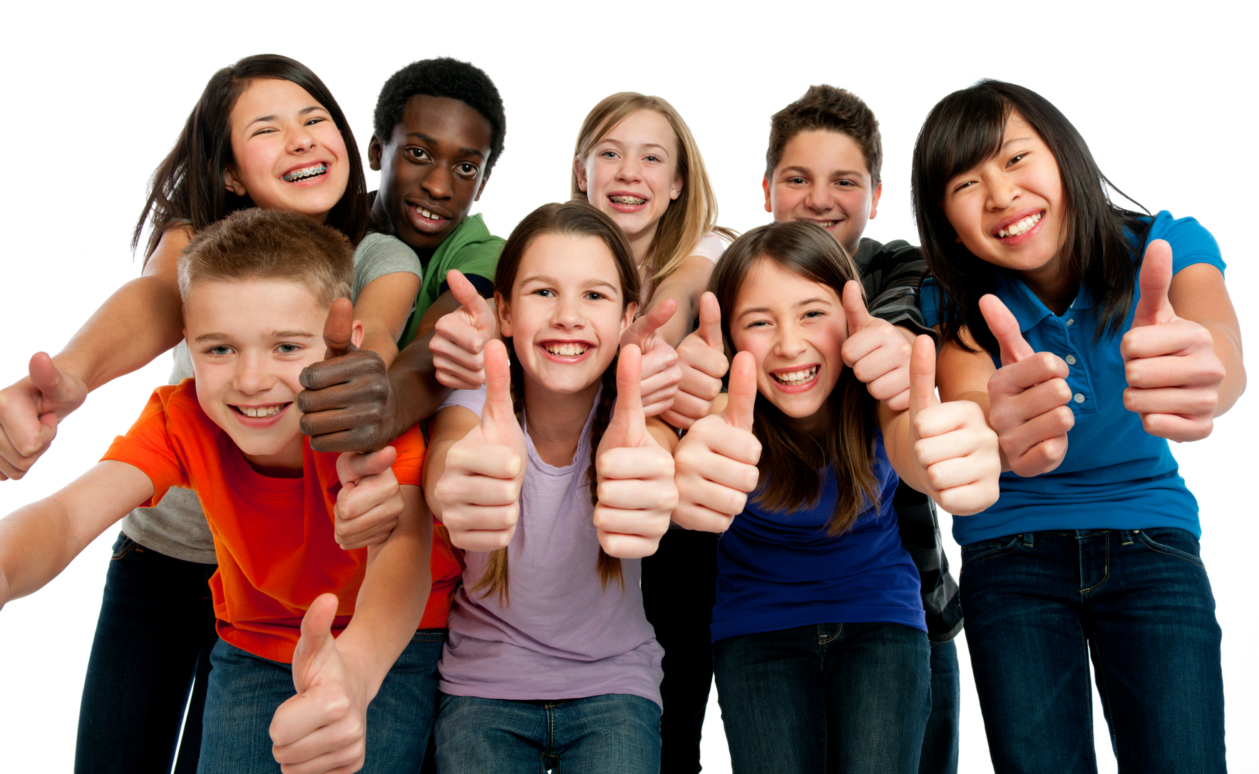 A diverse group of tweens giving thumbs up.